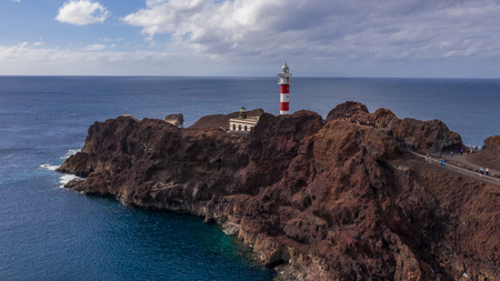 Aerial view of the lighthouse Teno on The Tenerife, Canary Islands, Spain. Wild Coast of the Atlantic Ocean Imagens