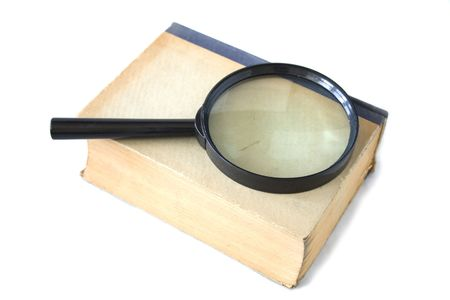 investigators: old book and magnifying glass