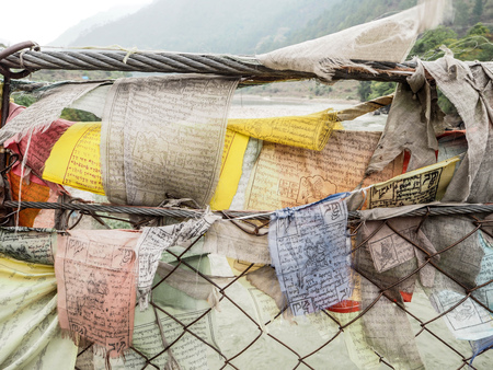 consecrated: Amulet Fabric hanging on the bridge - Bhutan Stock Photo