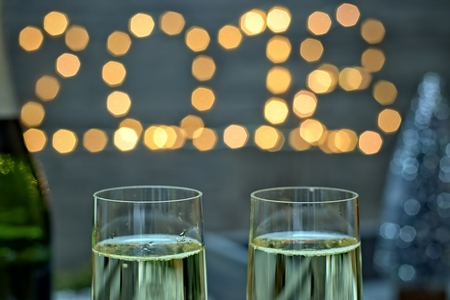 New year concept - champagne glasses on a blurry gold background new year.