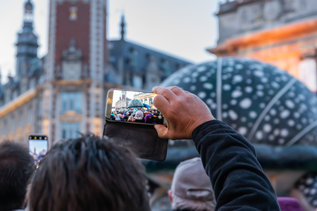 Lille, FRANCE-May 04,2019: Man who makes videos with a mobile phone Editorial