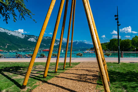 View of Annecy lake, boats with tourists and Alps mountains on sunny day with blue sky in Annecy city.Annecy is the largest city of Haute-Savoie department in France. Stock Photo