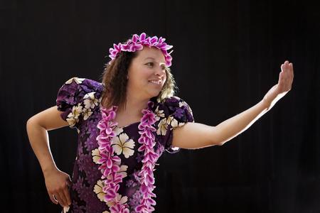 Hawaiian woman dancing and singing with musical instruments Banco de Imagens