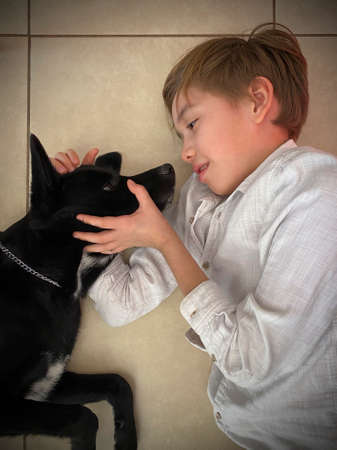 child caresses and plays with pet, cute attitude Imagens