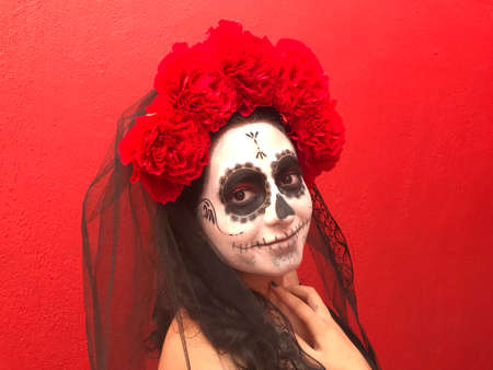 Mexican girl disguised as a Catrina on the Day of the Dead festival