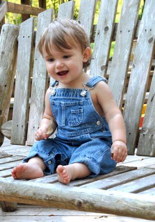 青いオーバー オールの少年 写真素材