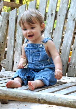 Boy in blue overalls