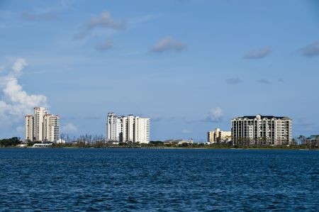 rentals: View of a series of high rise condos by the sea in a resort or vacation area.