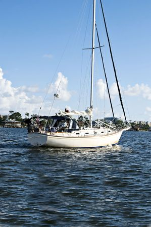 Sail boat touring the Gulf of Mexico on a beautiful summer day. Stock Photo