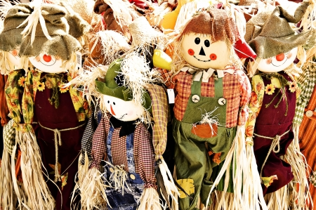 A  of scarecrows dressed in burlap and raffia.