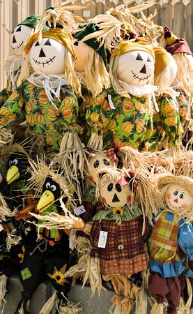 Scarecrows standing waiting to decorate for fall with. photo