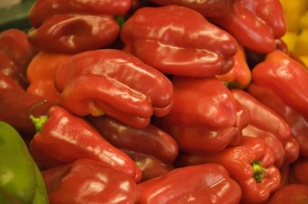 Display of Red Lucious Peppers in a produce market