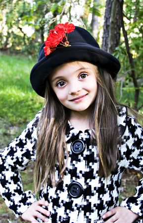 Beautiful brown eyed girl modeling with a hat.