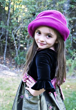 pink hat: Little brunette girl wearing a pink hat.