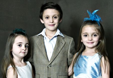 Three children posing for a portrait