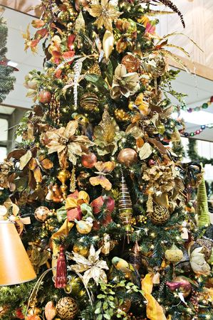 Beautiful floral Christmas tree decorated in gold trims