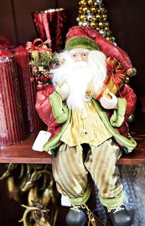 st  nick: Traditional Old St. Nick Santa sitting on shelf. Stock Photo