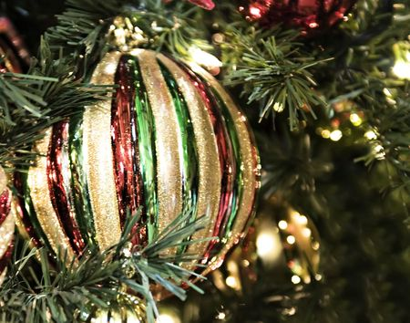 A bright and shiney red and green ornament