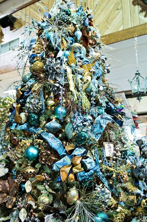 A christmas tree decorated with blue glitz and glitter
