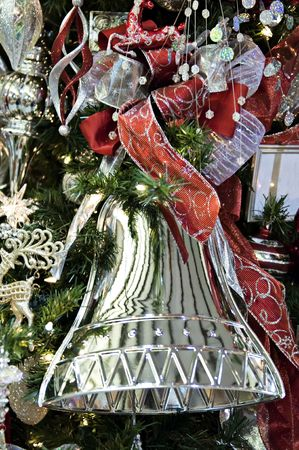 Beautiful, shiney, red, silver bell with ribbon