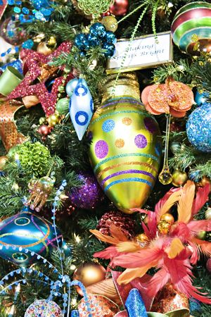 Christmas ornaments in colors displayed for holidays