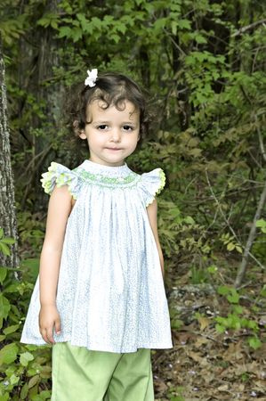 eyecontact: Adorable little girl dressed in a smocked top and pants