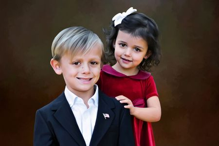 Blonde boy and brunette girl posing for a portrait photo
