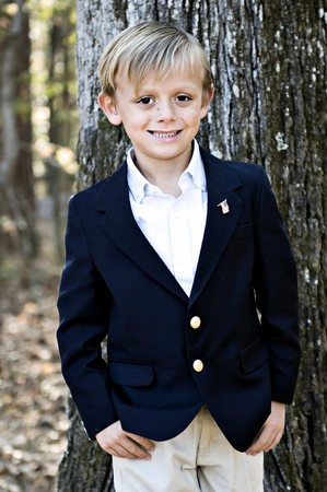 Handsome boy leaning on a tree dressed in a sport coat. Stock Photo - 3940328