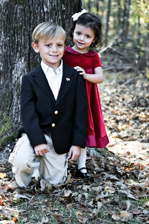 A little boy and girl dressed up for holiday. Stock Photo