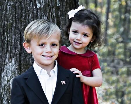 ハンサムな男の子とポーズかわいい女の子 写真素材