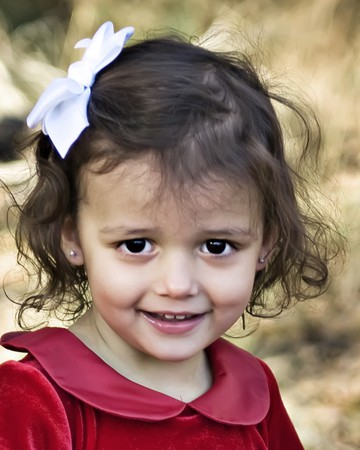 Precious little girl with a big smile close-up