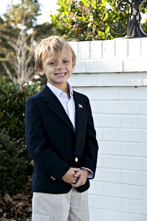 Handsome windblown smiling boy posing for photos