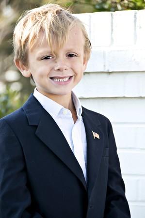 Cute blonde boy smiling for a portrait