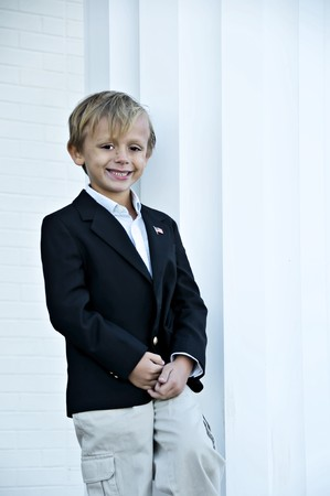 Young boy standing tall next to a column Stock Photo - 3959499