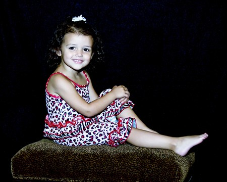 Little girl smiling and posing for a portrait.