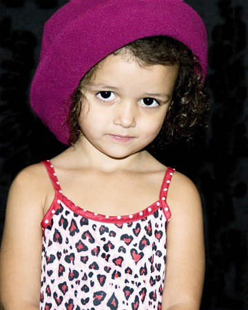 Little girl wearing a bright pink hat
