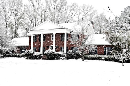An executive brick home graced with a beautiful new snow.