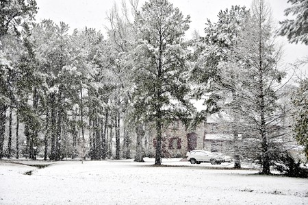 A rual executive home covered with fresh snow.