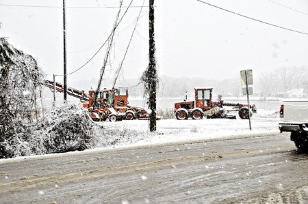 Heavy construction equipment in a snow storm. Stock Photo