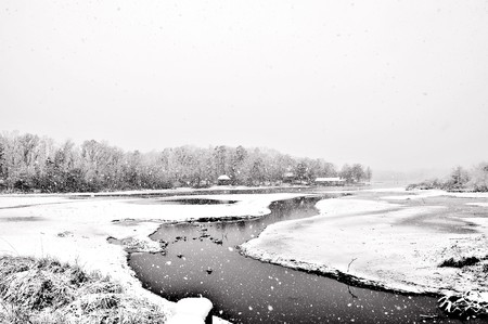 Fresh snow covering a lake making icy conditions.