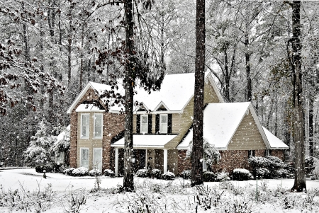 rural scenes: Snow falling on a beautiful executive home. Stock Photo