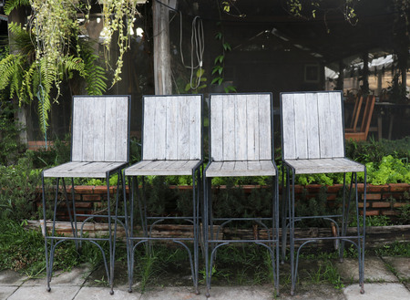 Outdoor chairs placed in the vegetable garden in Chiang Mai.