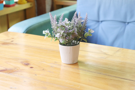 Vase of flowers in the cafe.