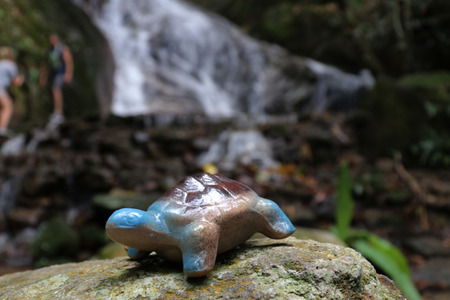 Ceramic turtles have been placed. The back side is a waterfall.