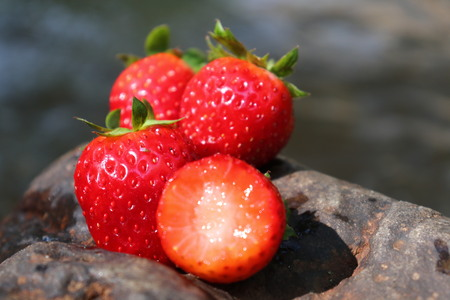 close-up of fresh strawberries put on a stone