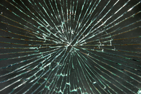 vandalize: Broken dirty car windshield glass with dust particles