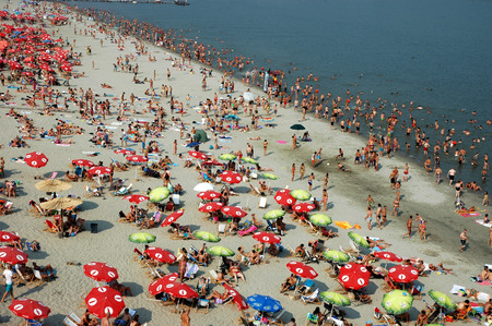 easy chair: Novi Sad, Serbia - July 18,2015:  People enjoy swimming, walking and sunbathing in the friendly environment on a beach called Strand on the Danube river.