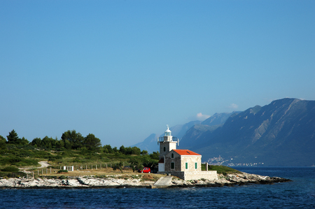 Seascape and lighthouse on the coast near Hvar island, Croatia
