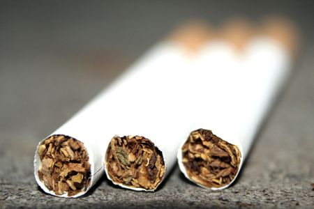 Some cigarettes are on a dirty floor. Don`t smoke Stock Photo - 835423