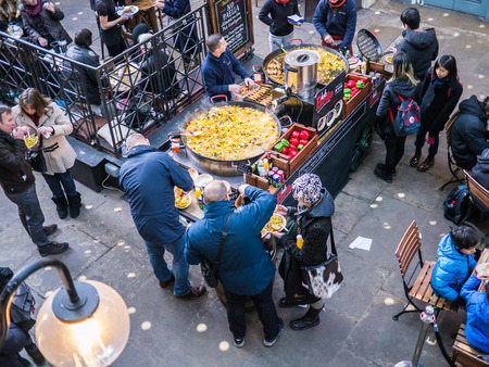 covent: Paella stand at Covent Garden, surrounded by diners, as seen from above, London, UK  Editorial